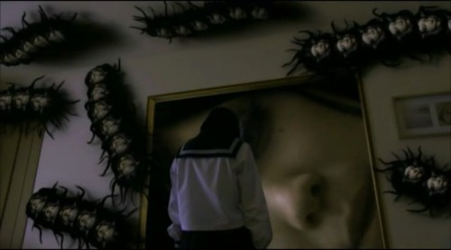 Some of the later incarnations of Tomie: Centipede Tomie and Giant Head Tomie.