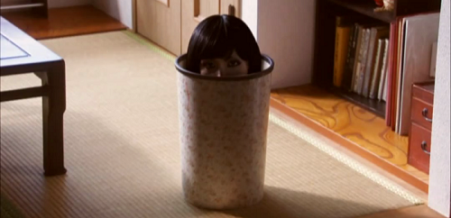 Tomie's head in a bin. Because when I kill anddismember my daughter, the best place to dispose of the body is in a wastepaper basket!