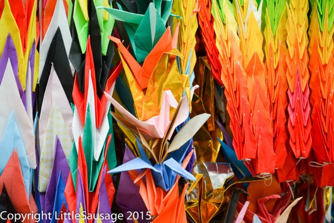Sadako believed that if she folded 1000 paper cranes then her wish would come true. This is why there are so many paper cranes at the children's and other monuments here.