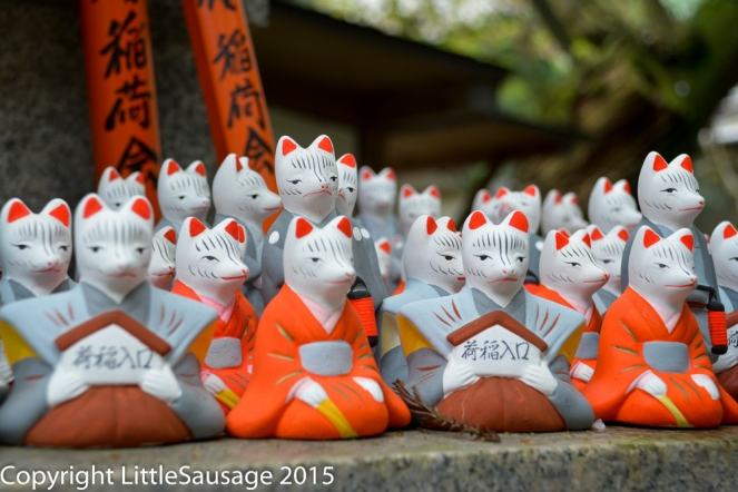 Hundreds of these tiny fox statues adorn the larger statues and shrines.